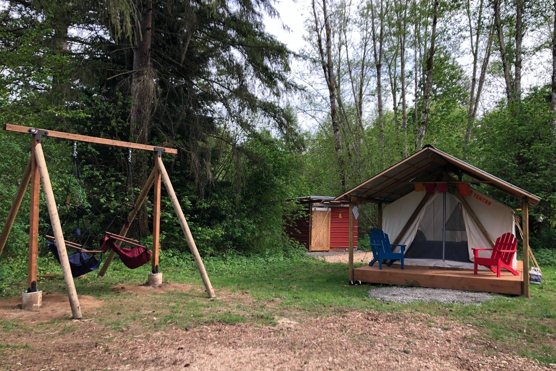 Glamping tent spot beside swingset.