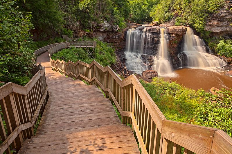 Wooden staircases that lead directly to the falls.